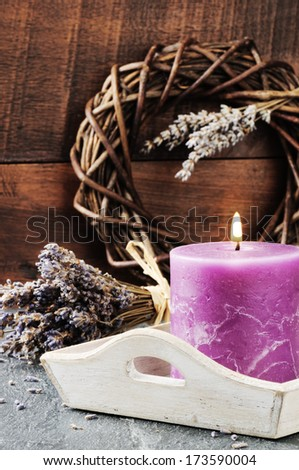 Fresh lavender flowers and scented candle. Wellness concept  - stock photo