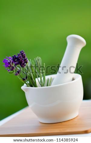 Fresh lavender  herbs in the mortar -  alternative medicine concept - stock photo