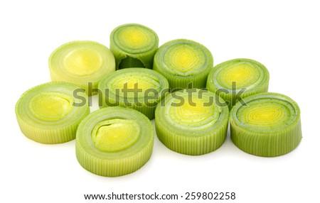 fresh leeks sliced on white background  - stock photo