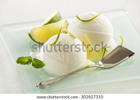 Fresh lemon and lime ice cream served on a plate. - stock photo