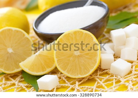 Fresh lemon and sugar - stock photo