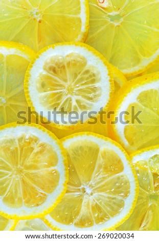 fresh lemon, background from lemon, sliced of lemon - stock photo