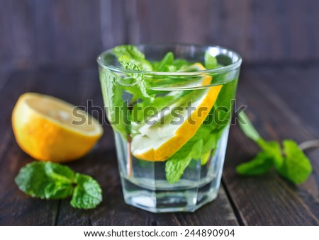 fresh lemon drink with sugar and mint - stock photo
