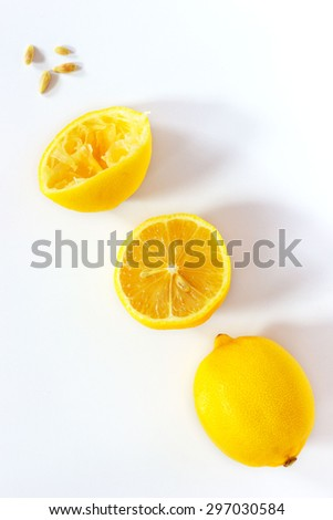 Fresh lemon in several stages, from fresh to pressed - stock photo