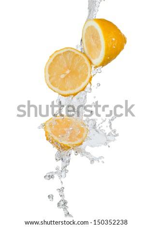 fresh lemon in water splash  - stock photo