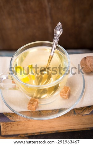 fresh lemon tea,lemon fruits on old book