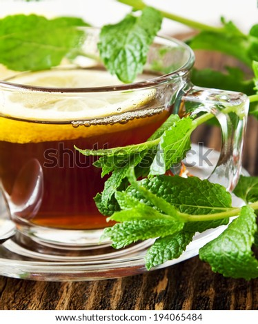 Fresh Lemon Tea with Mint Leaves in Transparent Cup