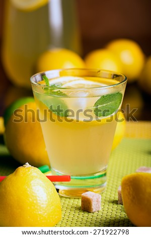 Fresh lemonade from lemon juice with mint and ice