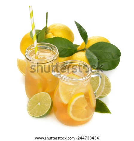 Fresh lemonade in a glass jug isolated on white background - stock photo
