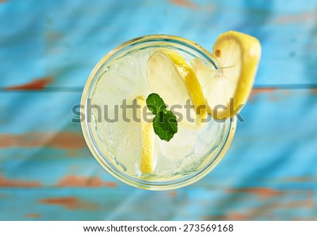 fresh lemonade with mint shot top down on rustic table - stock photo