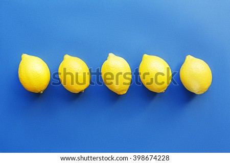 Fresh lemons in a row - stock photo