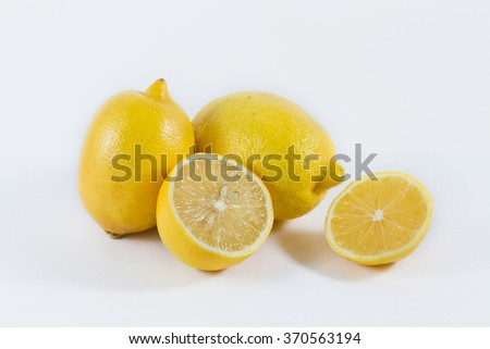 Fresh lemons on White ground - stock photo