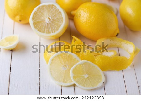 Fresh lemons on white wooden background. - stock photo