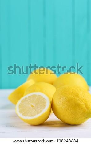 Fresh lemons  on  wooden background. Selective focus, vertical. - stock photo