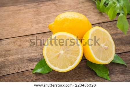 Fresh lemons on wooden table  - stock photo