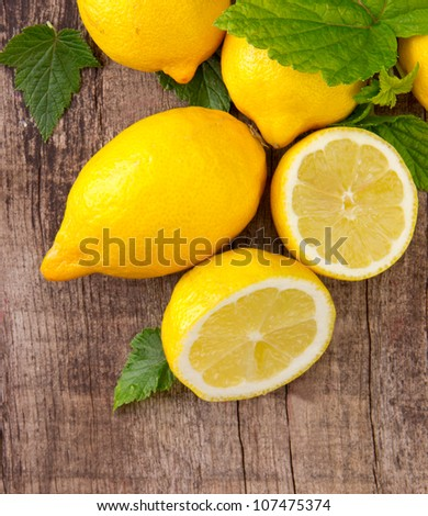 Fresh lemons on wooden table, top view - stock photo