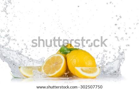 Fresh lemons with water splashes - stock photo