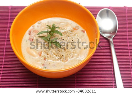 fresh lentil soup in an orange bowl