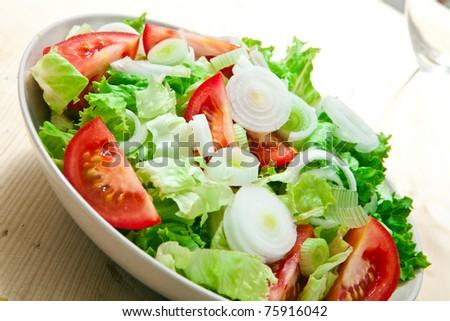fresh lettuce and tomato salad on bowl - stock photo