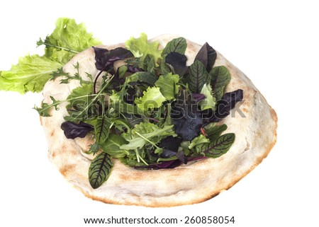 fresh lettuce on freshly baked pita bread - stock photo
