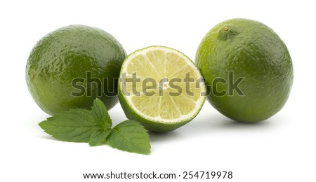 Fresh lime fruit with mint leaves isolated on white background