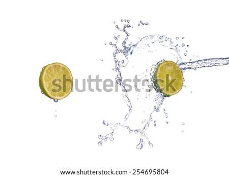 Fresh lime lemon with water splash in spray of water - stock photo