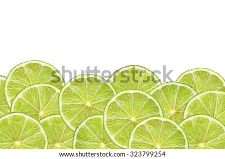 fresh lime slices on white background - stock photo