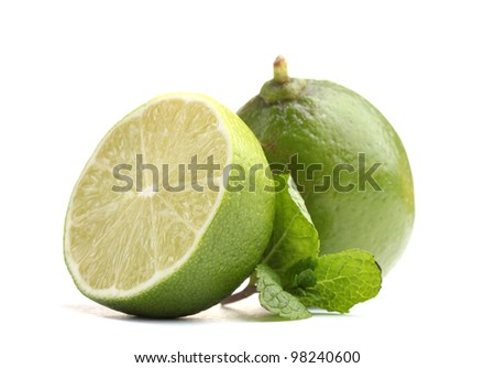 Fresh lime with mint isolated on white - stock photo