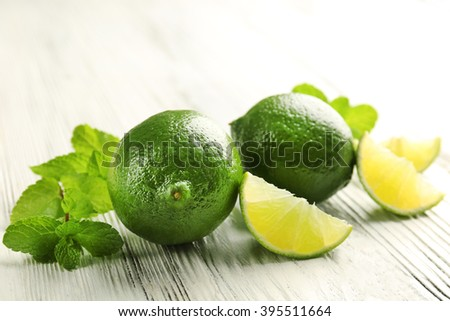 Fresh limes and mint, closeup - stock photo