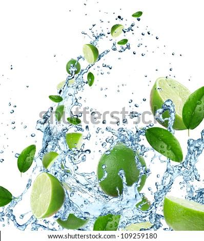 Fresh limes in water splash - stock photo