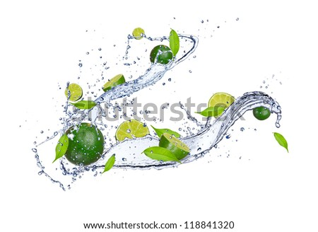 Fresh limes in water splash, isolated on white background - stock photo