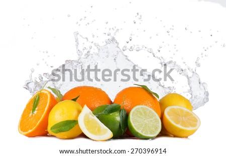 Fresh limes, lemons and oranges with water splashes isolated on white background - stock photo