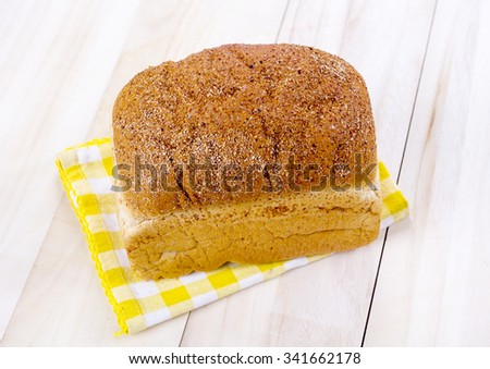 fresh loaf bread on mat fabric - stock photo