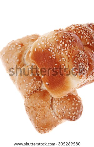 fresh loaf of light wheat bread topped by sesame seeds isolated over white background - stock photo