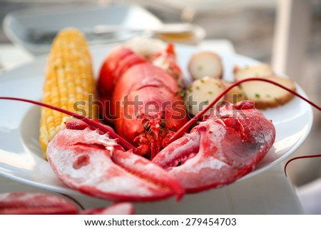 Fresh lobster with sweet corn and potatoes (shallow depht of field)