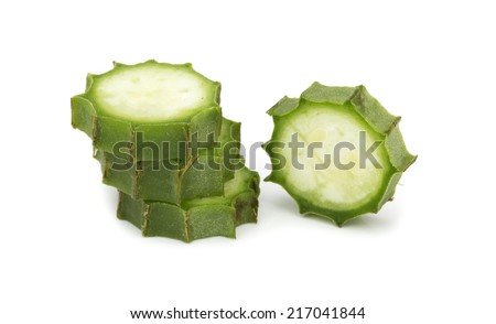 fresh loofah slice on the white background - stock photo