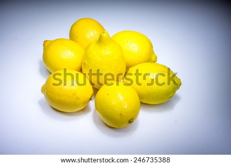 Fresh lucky seven lemons in light - stock photo
