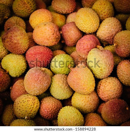 Fresh lychee. Exotic fruits background. Shadowed angles. - stock photo