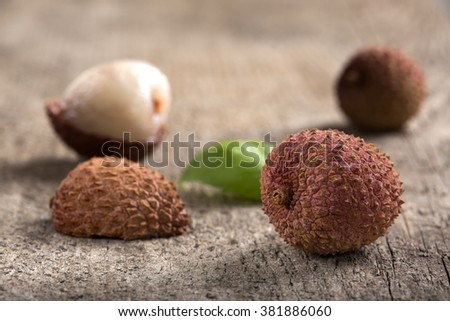 Fresh lychee on a wooden background - stock photo