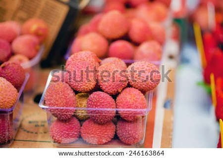 Fresh lychees on sale at the fruit market - stock photo