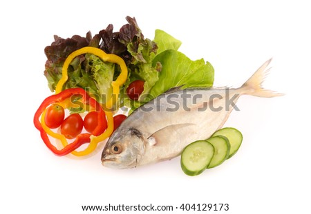 Fresh mackerel fish with vegetables isolated on white background