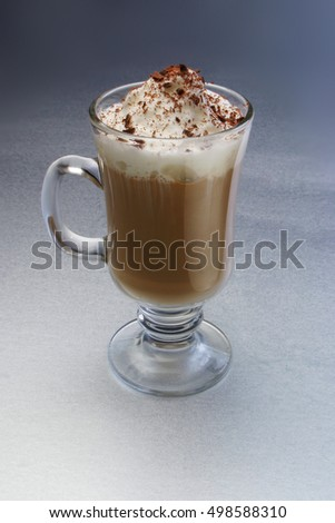 Fresh made cappuccino with whipped cream and chocolate flakes