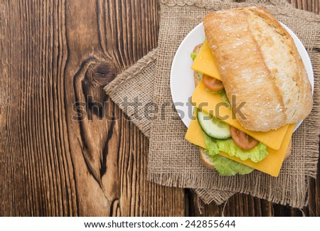 Fresh made Cheddar Sandwich on rustic wooden background (close-up shot) - stock photo