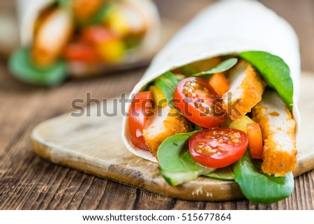Fresh made Chicken Wraps on an vintage background (selective focus)