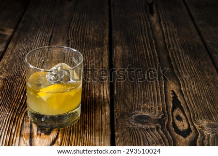 Fresh made Cocktail (Whiskey Sour) on dark wooden background - stock photo