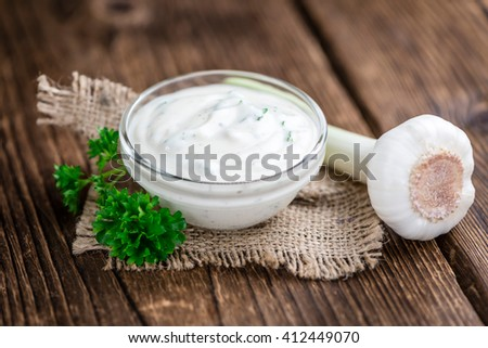 Fresh made Garlic Sauce (selective focus) on wooden background (detailed close-up shot) - stock photo