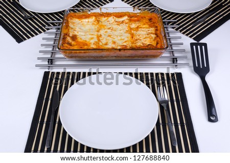 Fresh made lasagna ready to serve - stock photo