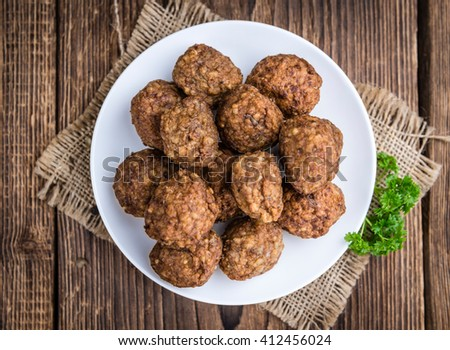 Fresh made Meatballs (close-up shot) on wooden background (selective focus)