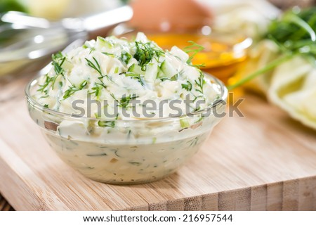 Fresh made Sauce Remoulade (close-up shot) on wooden background - stock photo