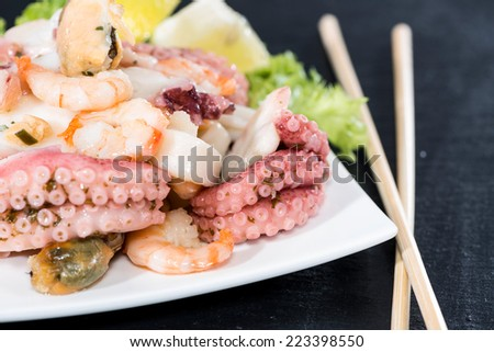Fresh made Seafood Salad with shrimps, mussels and quid (close-up shot) - stock photo